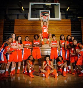 The Lady Panthers basketball team poses intensly.