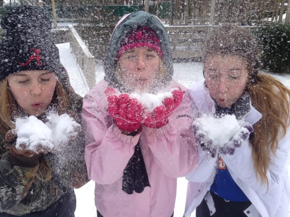Senior Kathryn Craven (center), junior Kimberly Peek (left) and sophomore Kathleen Hudson (right) enjoy the snow.
