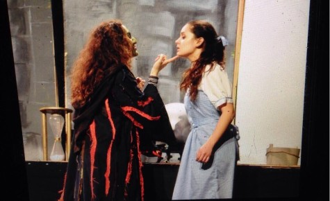 Zahira Jasani plays the Wicked Witch of the West, sneering at Paige Mullens, playing Dorothy.