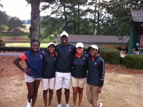 Parkview's varsity girl golfers celebrate their region win with coach Devon Walker.