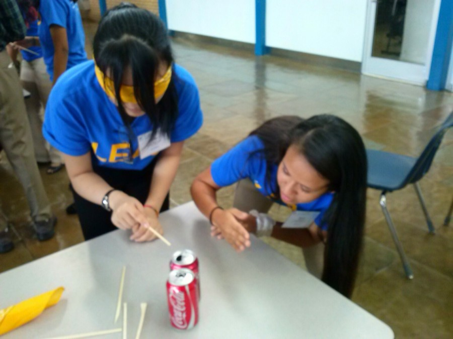 FBLA officers Maria Ortiz and Judy Liu complete a leadership communications activity.