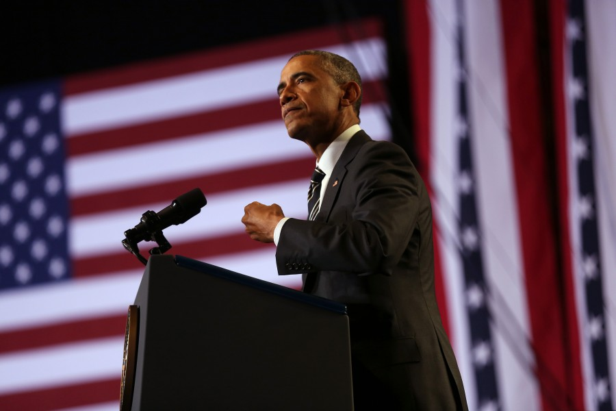 Obama visits Chicago to tout immigration action, cites Ferguson controversy.