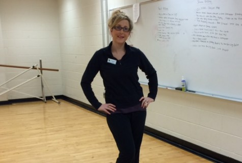 New dance teacher, Ms. Brown, posing in the dance room.