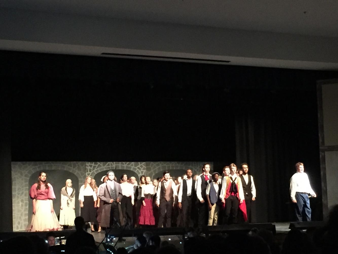 The final scene of Les Mis as they sing their final song (photo Courtesy Abby Harvey)