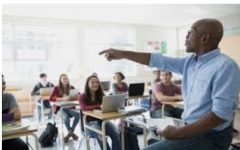 Stock photo of a teacher speaking to students.