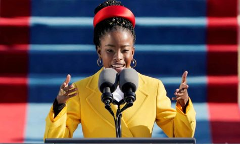 "Amanda Gorman performing her poem ""The Hill We Climb"" at the Inauguration of the 46th President. Courtesy of Reuters"